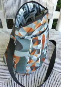 PLUS- there's MORE storage within the full-length zippered Flap